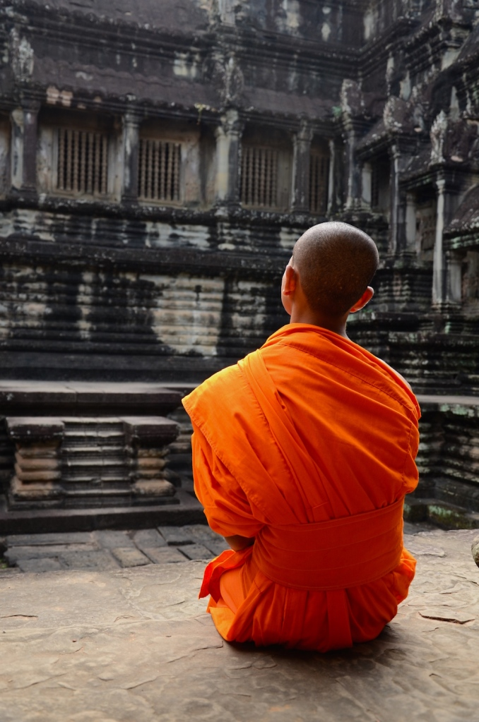 young monk in orange