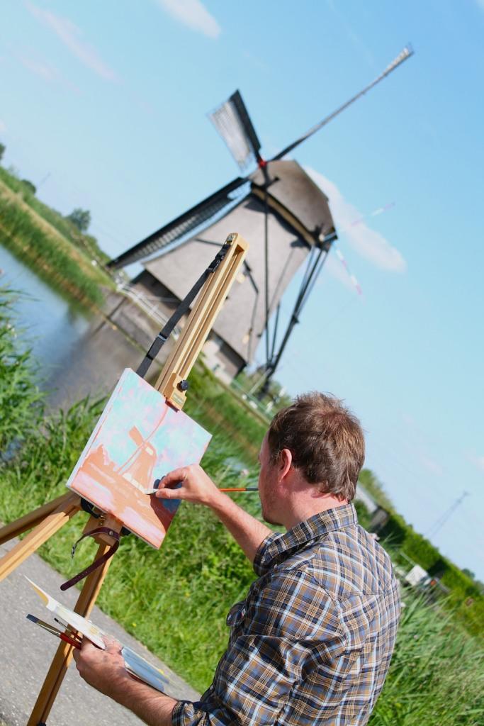 painter and windmill kinderdijk